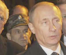 April 10, 2010, Crash Site in Smolensk, Russia: close-up showing General Rashid Nurgaliyev behind Vladimir Putin.