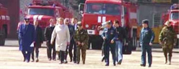 "Sergei Shoigu and his special-purpose group on the way to the crash site. A Spetsnaz Colonel (wearing a suit) is talking on a mobile phone. The Army General, Rashid Nurgaliyev (wearing a ""kepi"" cap), buttons his jacket."