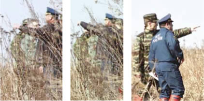 Smolensk Crash, 2010: Officers look around and point in different directions with their hands.